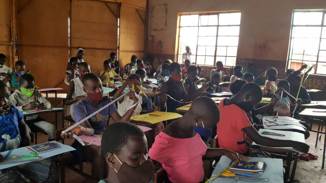 Girls learning to sew reuseable sanitary pads